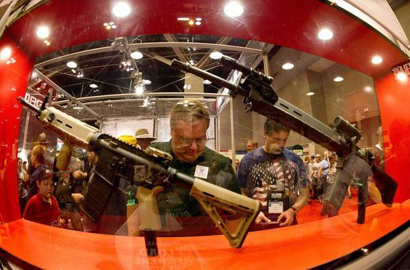 At the National Rifle Assn.'s annual meeting in April in St. Louis, plenty of firearms were on display. A poll finds that 92% of Americans want background checks for buyers at gun shows.