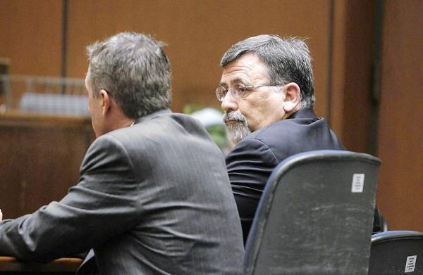 Newport-Mesa Unified Supt. Jeffrey Hubbard, right, looks at his lawyer, Sal Ciulla, after being found guilty of two felony counts Monday in Los Angeles County Superior Court. Hubbard said he plans to appeal the decision.
