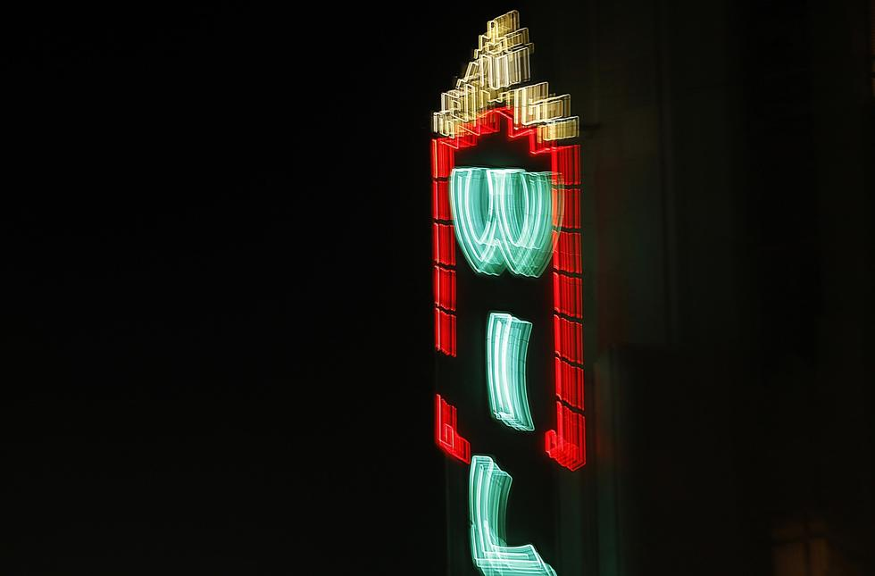 The neon marquee of the Wiltern, a landmark Art Deco theater, glows over the intersection of Wilshire Boulevard and Western Avenue. (Luis Sinco