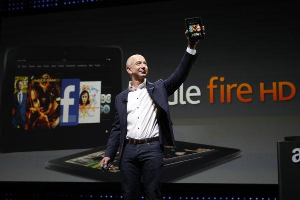 Amazon Chief Executive Jeff Bezos unveiling the Kindle Fire HD in September. Such tablet computers are helping to fuel the growth of e-book reading.