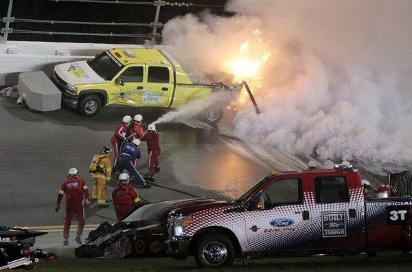 Emergency workers extinguish a fire burning a jet dryer during the NASCAR Daytona 500 on May 27. Juan Pablo Montoya's car struck the dryer during a caution flag, starting the fire, after something on the car broke. Matt Kenseth won the race.