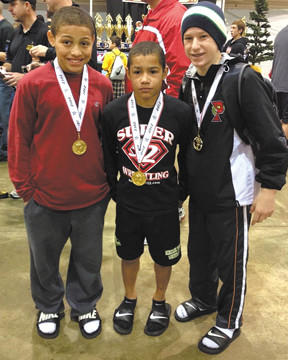 Aaron Brooks, left, Brian Stuart and Danny Bertoni were undefeated at the Virginia Challenge Holiday Duals in Richmond, Va. The trio are members of the Hagerstown Police Athletic Wrestling Club.