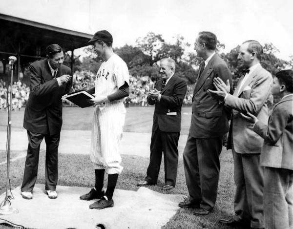 Baseball legend Babe Ruth presents his papers to Yale University in 1948. They are received by Yale baseball team captain, George Bush. Also present are: Bob Kiplurth, Yale Athletic Director; Professor James T. Babb, Yale University Librarian for Preservation; and Mayor Celentano with his son.