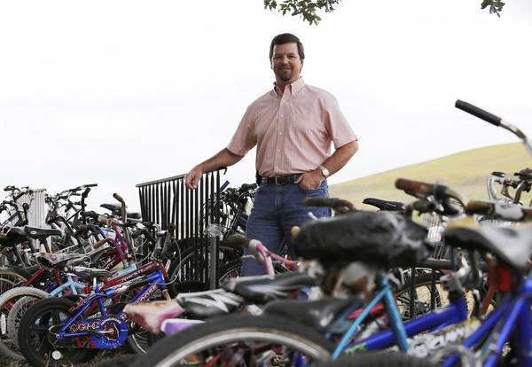 Solid Waste Division Manager Skip McCall, poses with about 100 bicycles on Friday, December 7, 2012. The bikes were delivered to Lake County recycling center. Some of the bikers were abandoned or confiscated by local police departments and the sheriff's office. Others were donated by residents to the county's recycling after kids outgrew them. Those who need a bicycle can pick one up for free by visiting the recycling center at 13130 County Landfill Road. (Tom Benitez/Orlando Sentinel)