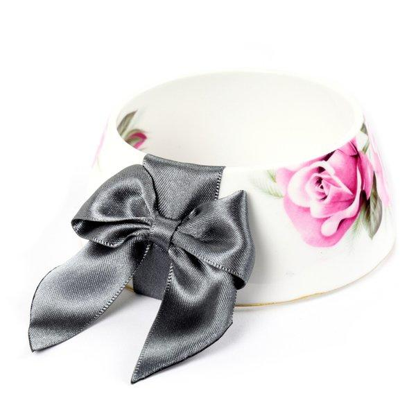 A bracelet made from a tea cup and adorned with a bow has vintage appeal.