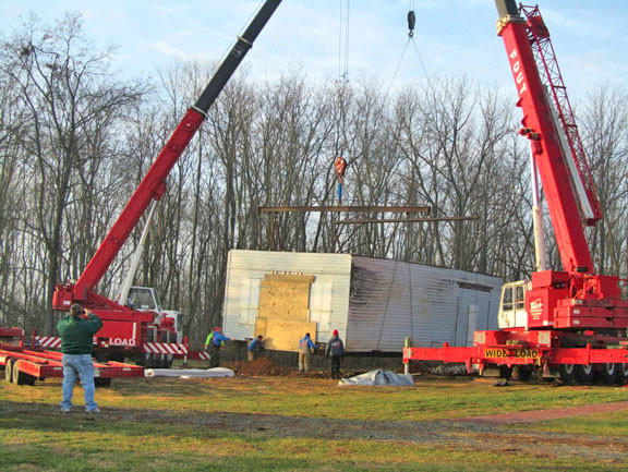 Cranes placed the roof on a country store Monday, Dec. 17, when it was relocated from near Clear Spring to the Rural Heritage Museum Village near Sharpsburg.