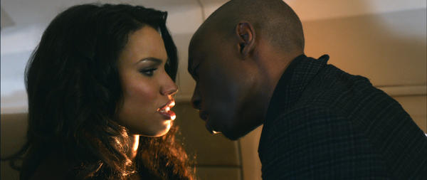 "A married marriage counselor (Jurnee Smollett) may not be able to control herself when she meets a man who treats her in ways her husband no longer does. Hubba! <br>What's new: In her largest big-screen role to date, Kim Kardashian stretches her range ¿ uh, by playing a beautiful, successful woman who wears tight clothing.  <br>What's not: Written, directed and produced by Tyler Perry, ""Temptation"" looks to blend Perry's usual, overheated melodrama with a story of infidelity that's as old as commitment."
