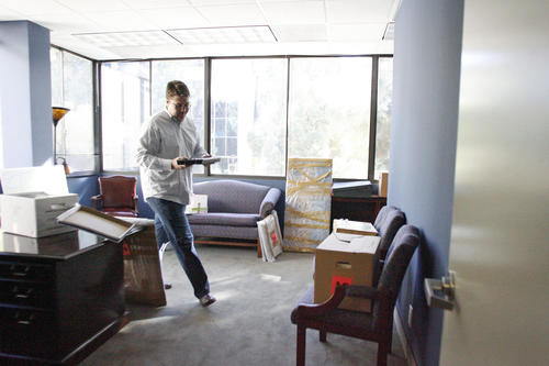Patrick Boland helps unpack boxes in the new office for Rep. Adam Schiff in Burbank on Thursday, December 27, 2012.