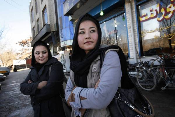 In Kabul, 2nd Lt. Sourya Saleh, 20, left, and 2nd Lt. Masooma Hussaini are Afghan air force helicopter pilots who were trained in the United States.