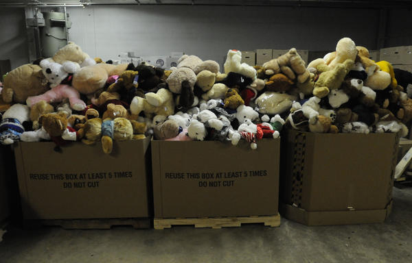 Hundreds of stuffed animals wait to be sorted.