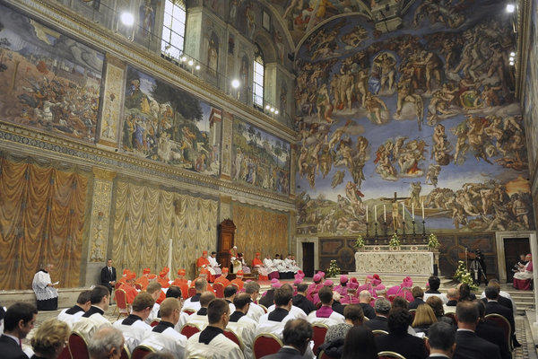 Pope Benedict XVI, seated at left, leads a vesper prayer in the Sistine Chapel in October.