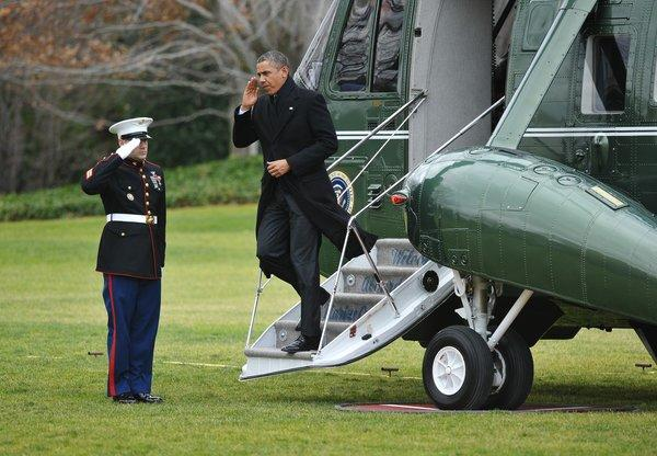 "President Obama steps off Marine One upon returning to the White House on Thursday. Obama returned to Washington under pressure to forge a deal with Republicans to avoid the tax hikes and spending cuts of the ""fiscal cliff."""
