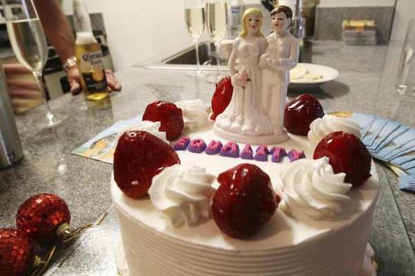 A cake topper of two women sits atop a cake at a bachelorette party for the couple in New York.