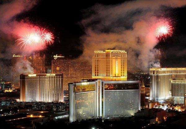 As 2012 dawns, fireworks erupt above the Las Vegas Strip.