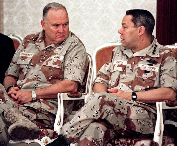 Gen. Norman Schwarzkopf, left, confers with Gen. Colin Powell, chairman of the Joint Chiefs of Staff, in Dhahran, Saudi Arabia, in 1990.