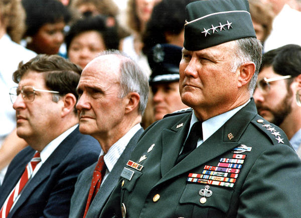 Gen. Norman Schwarzkopf, right,  commander of Operation Desert Shield, sits next to National Security Advisor Brent Scowcroft, center, and White House Chief of Staff John Sununu at the Pentagon in 1990.