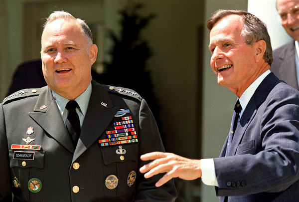 Four-star Gen. Norman Schwarzkopf, left, who commanded the international coalition that ousted Iraqi forces from Kuwait during Operation Desert Storm, is photographed with President George H.W. Bush at the White House on April 23, 1991.