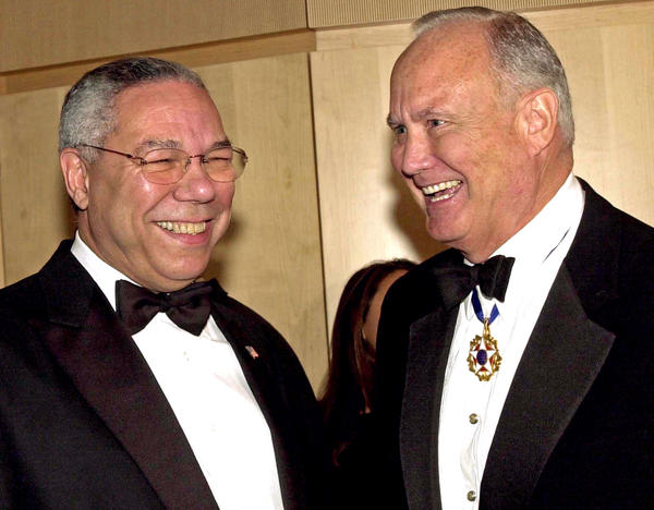 U.S. Secretary of State Colin Powell, left, and retired Gen. Norman Schwarzkopf chat at an awards ceremony honoring former President George H.W. Bush in Washington, D.C., on Dec. 6, 2002.