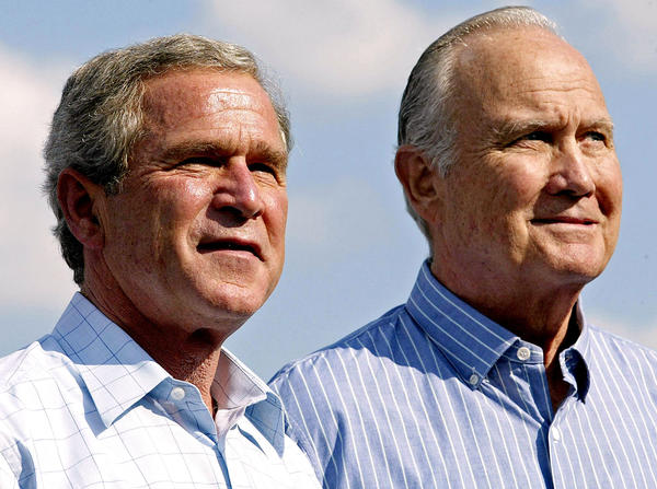 President George W. Bush, left, and retired Gen. Norman Schwarzkopf attend a Bush reelection campaign rally in Tampa, Fla., on Oct. 31, 2004.