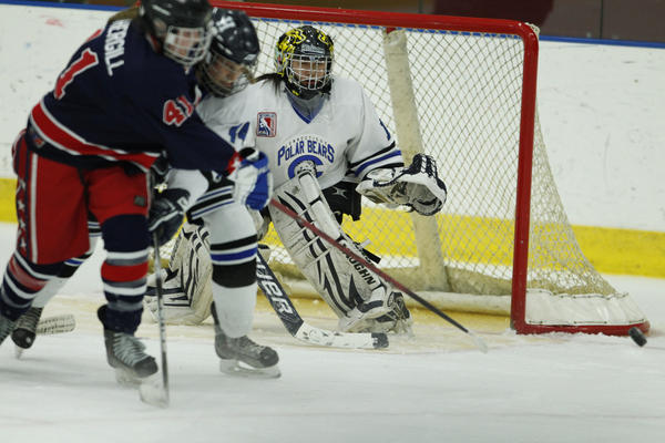 CT Polar Bears goalie Miranda Gohh and Alexa Lorillard (44) defend against the PA Lady Patriots' Sarah Fothergill in the third period during the CT Polar Bears Girls Ice Hockey Tournament at the Trinity Community Sports Complex. The Polar Bears won, 3-1.