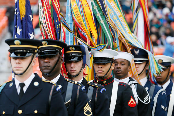 A military color guard prepares to take the field before the start of the Military Bowl game between Bowling Green Falcons and San Jose State Spartans  at RFK Stadium on December 27, 2012 in Washington, DC.