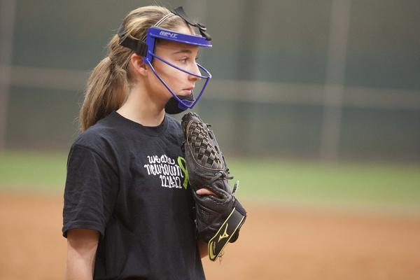 Ali Nuzzo plays third base for Newtown's softball team for 12-year-olds against Monroe's team at Fast Pitch Nation, an indoor softball facility in Bloomfield.