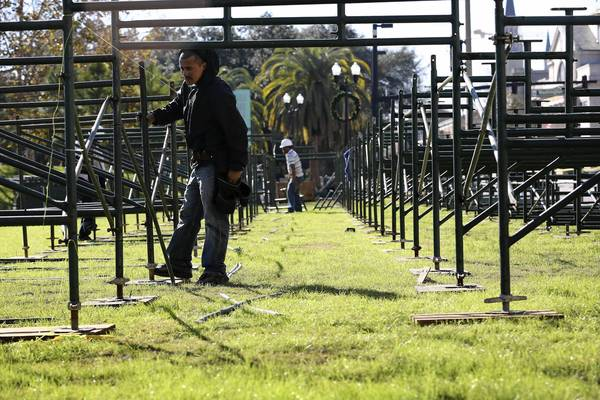 Workers assemble the bleachers for the Orlando Citrus Parade reserved seating along Rosalind Ave near Lake Eola Park. The parade is Saturday, December 29 at 10 a.m.