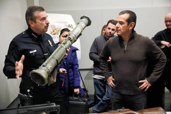 Los Angeles Police Chief Charlie Beck shows off one of two rocket-launchers turned in during the Dec. 26 gun buyback program, the city's most successful ever.