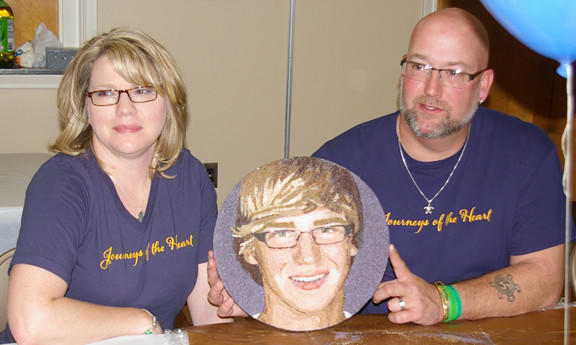 Sonja and Tom Hoover, parents of Quinn Hoover, who died March 18 in a car accident, are shown with a floragraph of Quinn's image. The floragraph will will be part of the Journeys of the Heart float in the Tournament of Roses Parade that will honor Quinn and 71 other organ, eye and tissue donors.