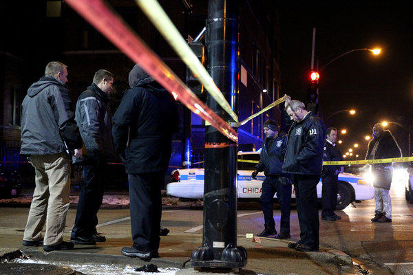 Chicago police investigate the scene of a fatal shooting at 1000 North Lavergne on Chicago's West Side.