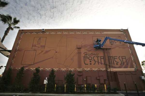 Allyson Jones Wong paints a mural on the side of a building at 1534 Adams Ave on Tuesday. (Scott Smeltzer)