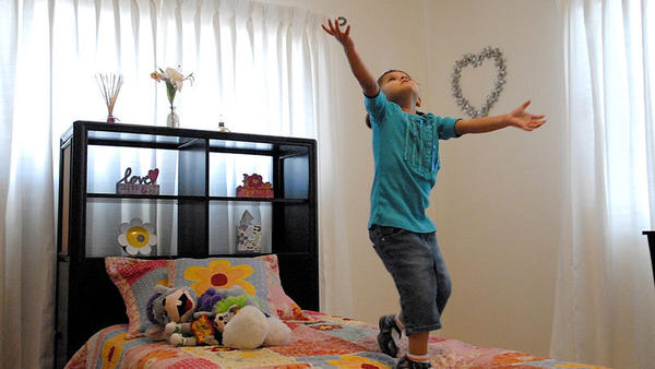 Four-year-old Valeria Ramos dances on her bed in her room that was made over by the Make-A-Wish Foundation due to the life-threatening heart condition Ramos suffers from.