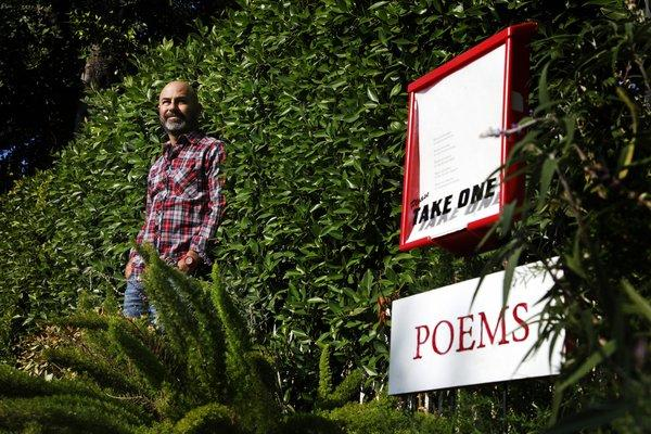 Silver Lake resident Peleg Top stands by the Moreno Drive poetry box that has won so many fans.