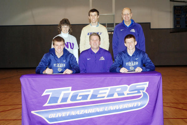 Former Burt Lake Northern Michigan Christian Academy standouts Paul Chatfield (front, left) and Aaron Chatfield (front, right) sign National Letters of Intent to attend Olivet Nazarene University, where theyll join the Tigers mens soccer team. Joining the Chatfield brothers at their signing is Olivet Nazarene coach David Blahnik (front, center), mother Betty Chatfield (back, from left) brother and NMCA boys soccer coach Lee Chatfield and father Rusty Chatfield.