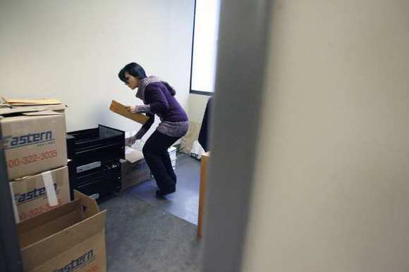 Mary Hovagimian helps unpack some boxes in the new office for Rep. Adam Schiff in Burbank on Thursday, December 27, 2012.