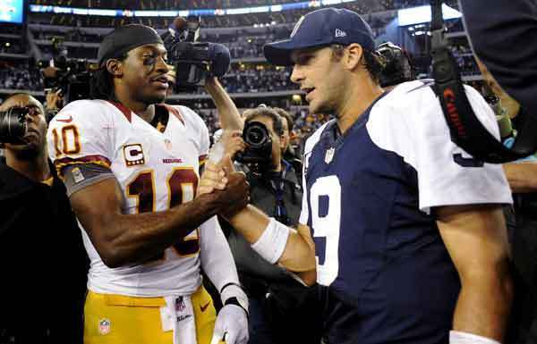 Robert Griffin III, left, and the Redskins beat Tony Romo and the Cowboys on Thanksgiving Day.