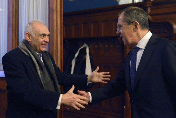 Russian Foreign Minister Sergei Lavrov, right, welcomes his Egyptian counterpart Mohamed Kamel Amr prior to a meeting in Moscow.