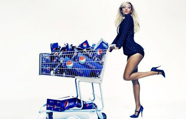 Beyonce strikes a pose while literally pushing some product.