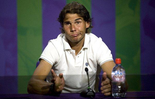 Rafael Nadal addresses the media after his second-round loss at Wimbledon. He hasn't played since because of knee problems, and now he has postponed his return to the court because of a stomach virus.
