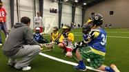 Several lacrosse stars held a youth clinic Thursday in Newtown, Conn., in the wake of a shooting that killed 20 children and six adults Dec. 14 at Sandy Hook Elementary School.
