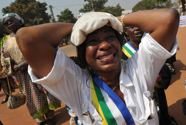 A member of the Central African Republic's national assembly cries while praying Friday during a women's protest in Bangui, the capital, against the conflict in their country.