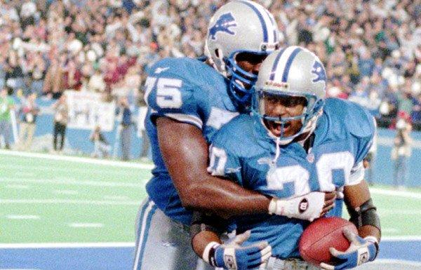Lions tackle Lomas Brown (75) gives running back Barry Sanders a hug after a touchdown against the Vikings in 1995.