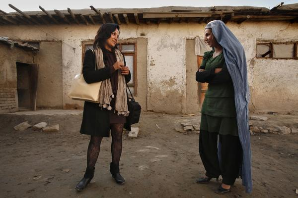 "Fereshta Kazemi, left, visits the set of ""Kocha-e-Ma"" (Our Street), a drama series she will soon star in with Brishna Bahar, an Afghan actress, at right."