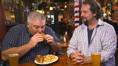 Chef Todd tries the triple-decker BLT sandwich at the Green Door Tavern.