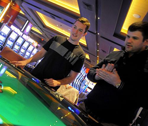 Chris Martin (left) and Kevin Carlson play Royal Match 21, at Maryland Live casino.