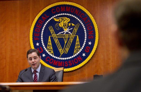 Julius Genachowski, chairman of the Federal Communications Commission, supports new rules on pay-phone rates for prisoners and their families.