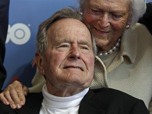 In this June 12, 2012, file photo, former President George H.W. Bush and his wife, Barbara, arrive for the premiere of HBO's documentary about his life in Kennebunkport, Maine.