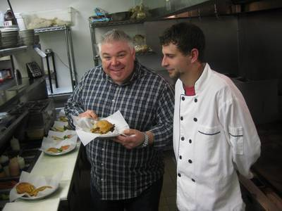 Ched Todd and Chef Alex discuss the Barrie Burger at AJ Bombers. The Barrie Burger is made with chunky peanut butter, bacon and cheese.