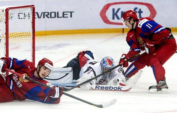 American goaltender John Gibson battles for a loose puck against Russian forwards Danil Zharkov, left, and Yevgeni Mozer during the second period Friday.