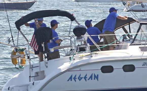 The crew of the Aegean, a 37-foot sloop from Long Beach, are pictured crossing the starting line of the 2012 Newport to Ensenada Yacht Race in April.